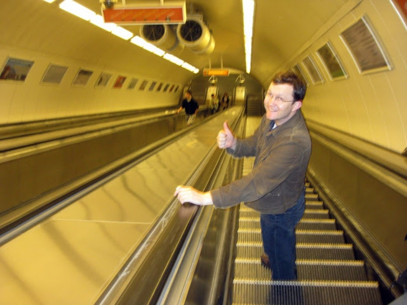 going down a subway escalator in budapest